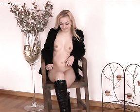 Nubile naked girl with small round tits exposes her flawless shapely figure on the online vid