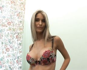 Glamour naked girl reveals her big pussy and astonishing fake boobs