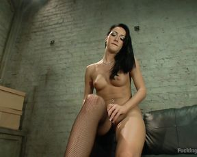 Naked girl in fishnet stockings uses a sex machine and a toy in order to cum