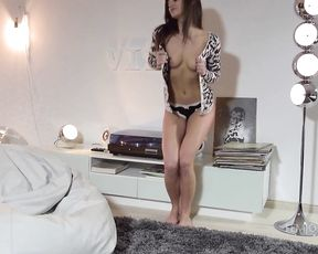 Kinky naked girl demonstrates her stunning lean body from all sides