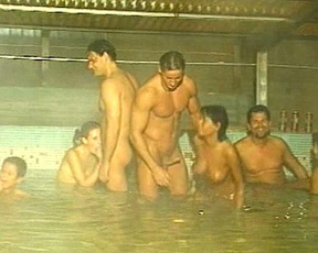 Naked girls and men have an orgy in the swimming pool and cum like crazy