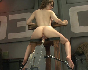 Fucking dildo machine destroys this naked girl's tight pussy until she cums