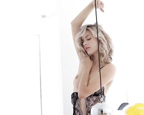 Stunning blonde haired blonde gets naked and shows her hairy pussy