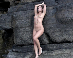 Gorgeous naked girl teases and masturbates showing off her shaved pussy