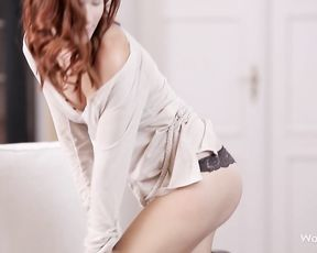 Spicy redhead likes touching her tits and pussy in such solo scenes