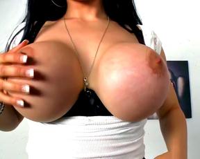 Casting brunette reveals her huge tits in a very impressive closeup