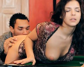 Busty brunette playing pool gets seduced and fucked hard on the table