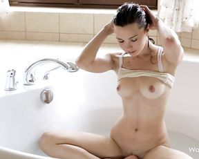 Try not to cum watching this hot naked brunette playing in the bathtub