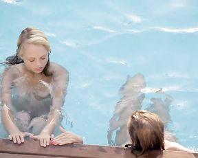Two horny bitches start eating eachother's pussies on the side of the pool