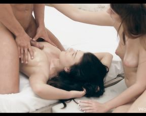 Two chicks with awesome bodies finish up a hot stud after a massage and fucking