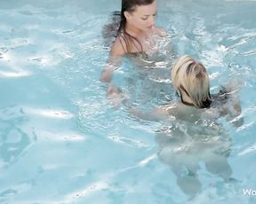 Two lesbians touching in the pool turns into a massive fuckfest