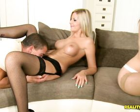 Two stunning teen girls in sexy stockings get involved into a gangbang action