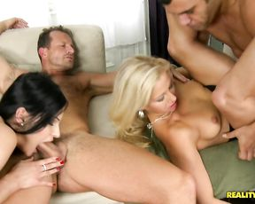 Two couples decide to have a fuck contest on a contest to see who cums first