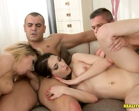 Two sluts and two cocks have themselves a good fucking on the couch