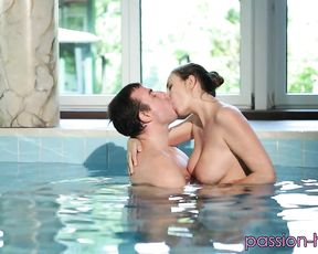 After a swim, a couple starts fucking with intense passion in the shower