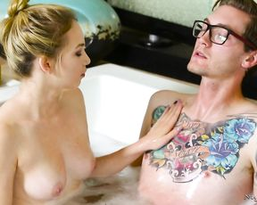 Petite blonde gets a hard fucking in the shower from a tattooed guy