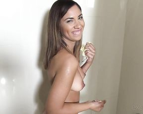 Teen sucks cock in the shower while posing nude and acting slutty