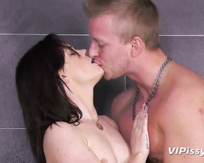 Brunette bitch fucks a huge cock in the shower and takes jizz down her throat