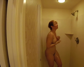 MILF gets seduced by her stepson in the shower and starts blowing him off
