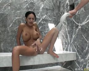 Brunette slut with huge fake tits gets in the shower and masturbates like crazy