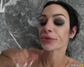 Brunette slut with fake tits gets throat fucked in the shower by a big cock