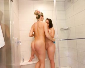 Two sluts with huge tits cum when eating eachother's pussies in the shower