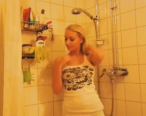 Appealing nude blonde flashes tits in the shower while on cam