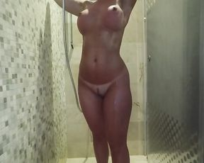 Naked babe bends ass for doggy style in superb shower scenes