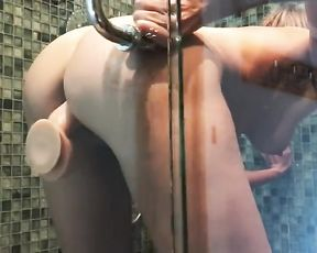 Hot assed babe stuffs her pussy with a dildo dong in the shower and masturbates