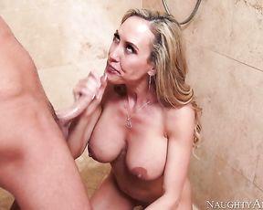Cum-thirsty vixen deepthroats her lover's cock in the shower swallows jizz