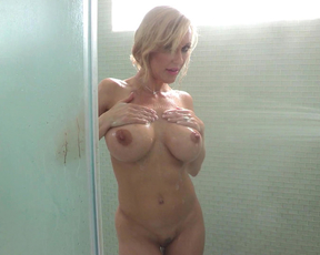 Alluring busty vixen goes naughty in the shower masturbates with the hot water