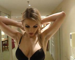 Gorgeous girl in black stockings poses on cam before having shower