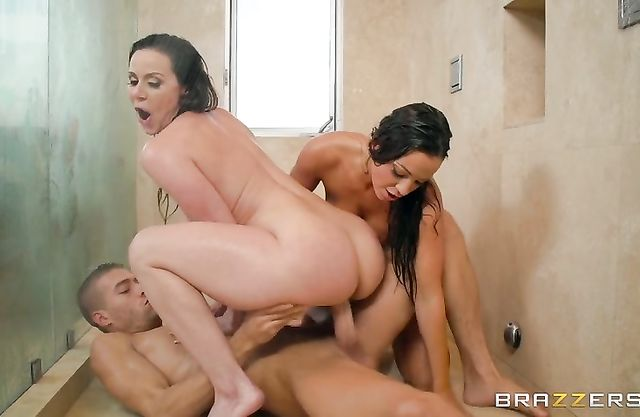 Two smoking hot bitches with wet bodies share a hard cock in the shower