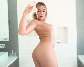 Glamorous girlfriend soaps and creams her body in the shower and shows off