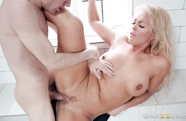 Tight blonde gets a lot of dick in her gorgeous pussy during hard sex in the shower