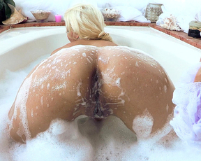 Impressive fuck play in the shower with a naked blonde slut with big tits