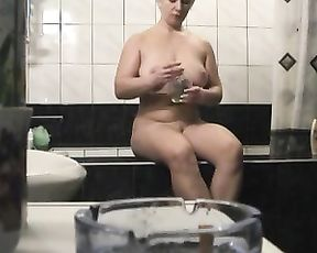 Chubby mature mom masturbates her pussy in the shower and strokes her tits