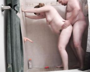 Fat naked slut deepthroats her guy's dick in the shower and gets banged hardcore