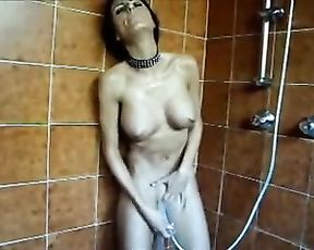 Skinny milf sends a stream of water on her needy pussy in the shower