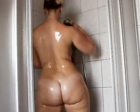Big-assed slut with a massive fat body takes a shower and fondles herself