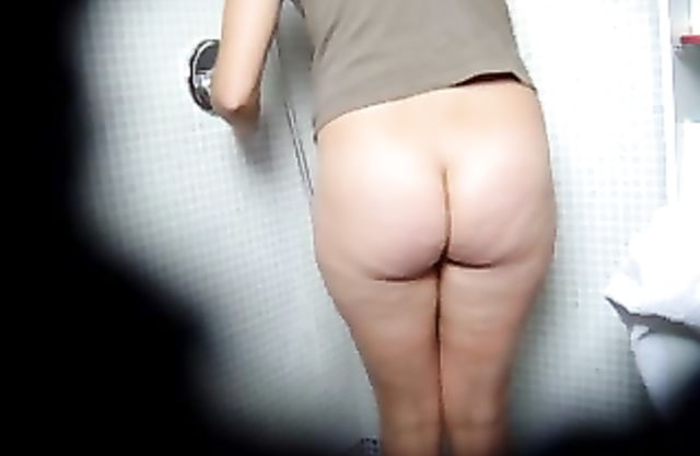 Big assed chick masturbates her hairy pussy while taking a shower