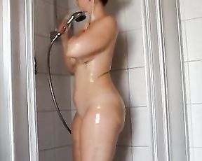 Curvy chick washes and strokes her big juicy body while taking a shower