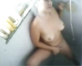 Slutty naked chick takes a shower and masturbates her pussy in the process