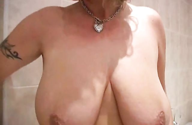 Hot busty vixen with huge bouncing boobs gets naked to have a shower