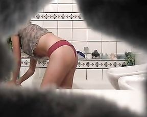 Very sexy naked babe strokes her adorable body in the shower on a hidden cam
