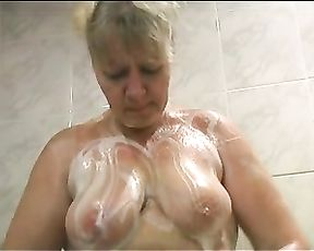 Nude mature plays with her soapy pussy in insane solo porn scenes