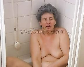 Naked mature tries masturbating in the shower while being filmed