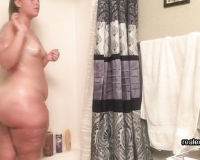 Big ass milf taped in the shower when touching her self in soft modes