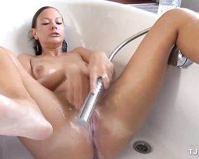 Solo masturbation in the shower for a naked brunette with amazing curves