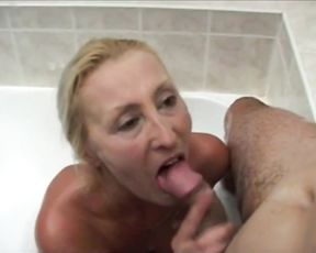 Mature whore enjoys soapy sex in the shower and engulfs a huge boner